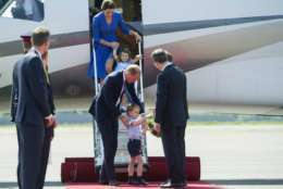 Britain's Prince William, center left, and his wife Kate, the Duchess of Cambridge with their children Prince George and Princess Charlotte at the airport in Berlin, Wednesday, July 19, 2017. The British royal couple is on a three-day-visit in Germany. (Steffi Loos/Pool Photo via AP)