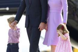 Britain's Prince William, second left, and his wife Kate, the Duchess of Cambridge, second right, and their children, Prince George, left, and Princess Charlotte, right look at helicopters during their visit to Airbus in Hamburg, Germany, Friday, July 21, 2017.  ( Christian Charisius/Pool Photo via AP)