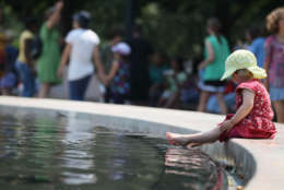 WASHINGTON, DC - JUNE 09:  Ronja Lerche, 2, of Erfurt, Germany, puts her feet in the fountain at the National Gallery of Art Sculpture Garden, on June 9, 2011 in Washington, DC. A heat advisory is in effect for the Washington area, and temperatures are expected to be in the middle to upper 90s this afternoon.  (Photo by Mark Wilson/Getty Images)