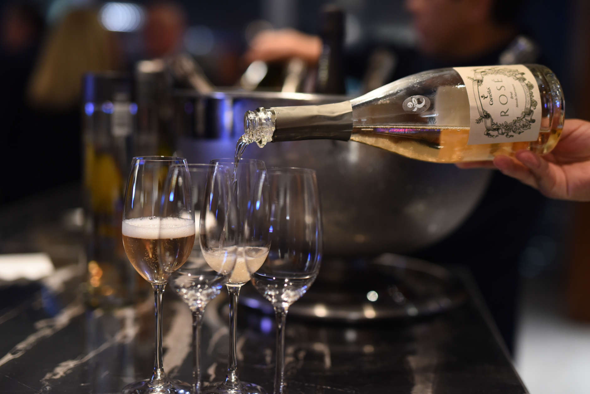NEW YORK, NY - OCTOBER 13: Canella Spumante Rosé Brut being poured at a Dinner hosted by Chrissy Teigen and Mario Batali part of the Bank of America Dinner series curated by Chefs Club at Bank of America Building on October 13, 2016 in New York City.  (Photo by Dave Kotinsky/Getty Images for NYCWFF)