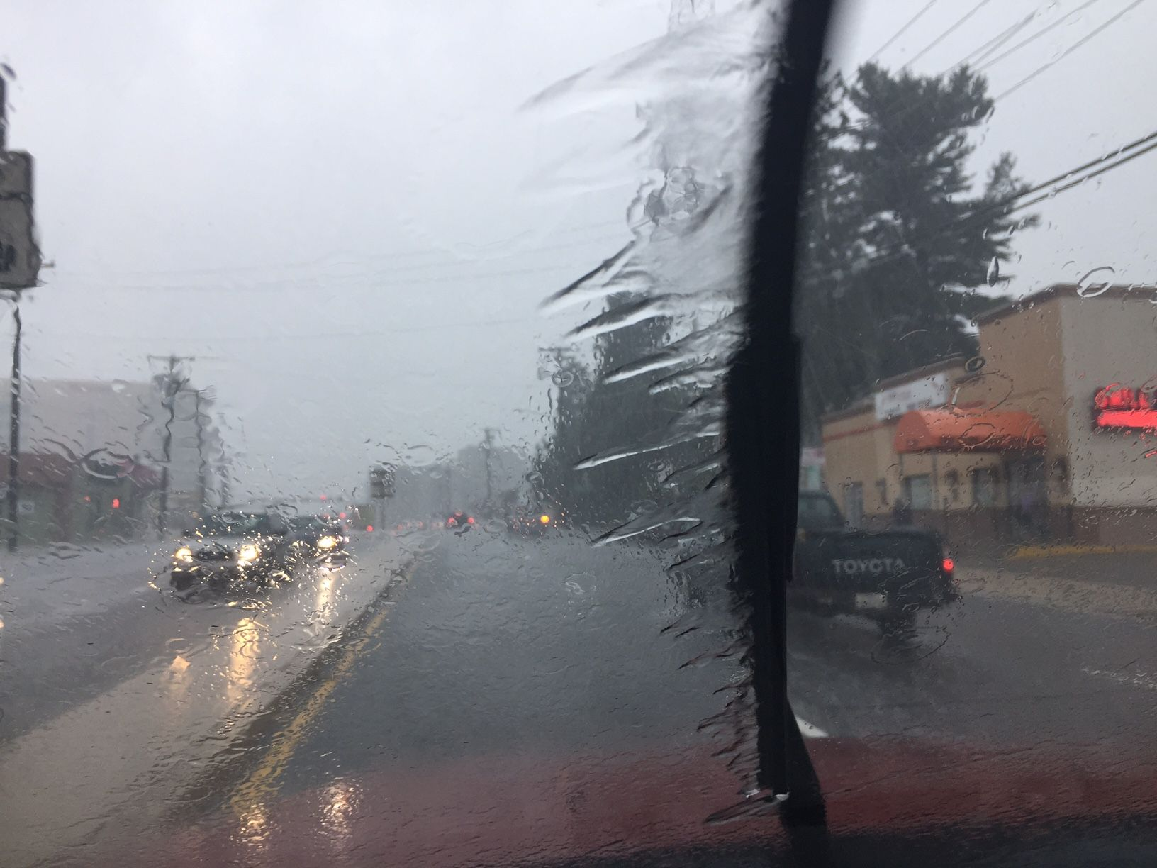 Rain slams drivers in Wheaton, Maryland on Friday. (WTOP/Rich Johnson)