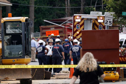 Utility contractor trapped in trench dies