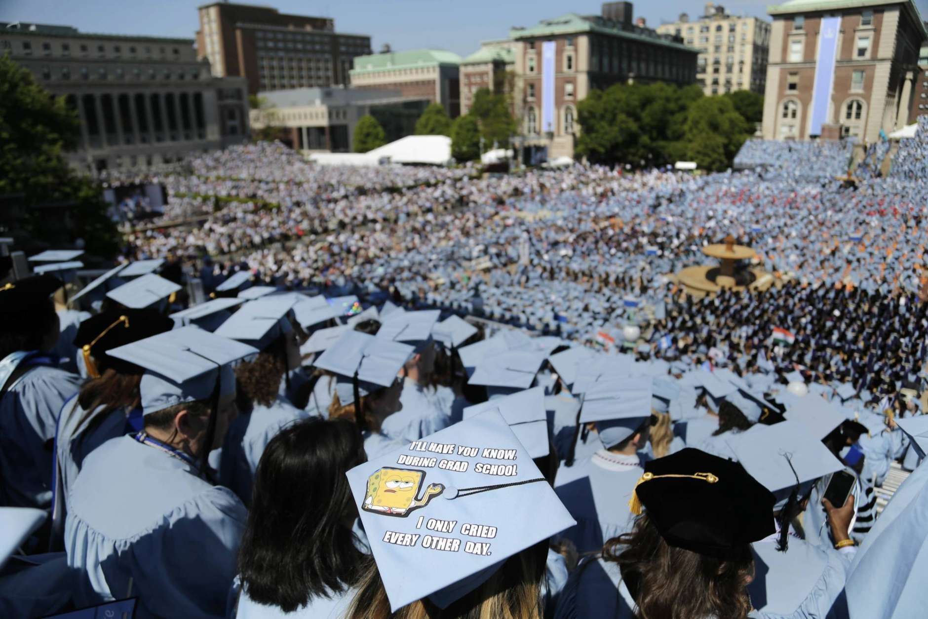 FILE - In this Wednesday, May 17, 2017, file photo, graduating students fill the Columbia University campus during a graduation ceremony in New York.. (AP Photo/Seth Wenig, File)
