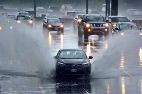 Slick roads, flood warnings make for messy weekend