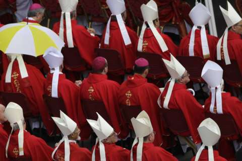 Pope removes German cardinal as sex abuse crisis catches up