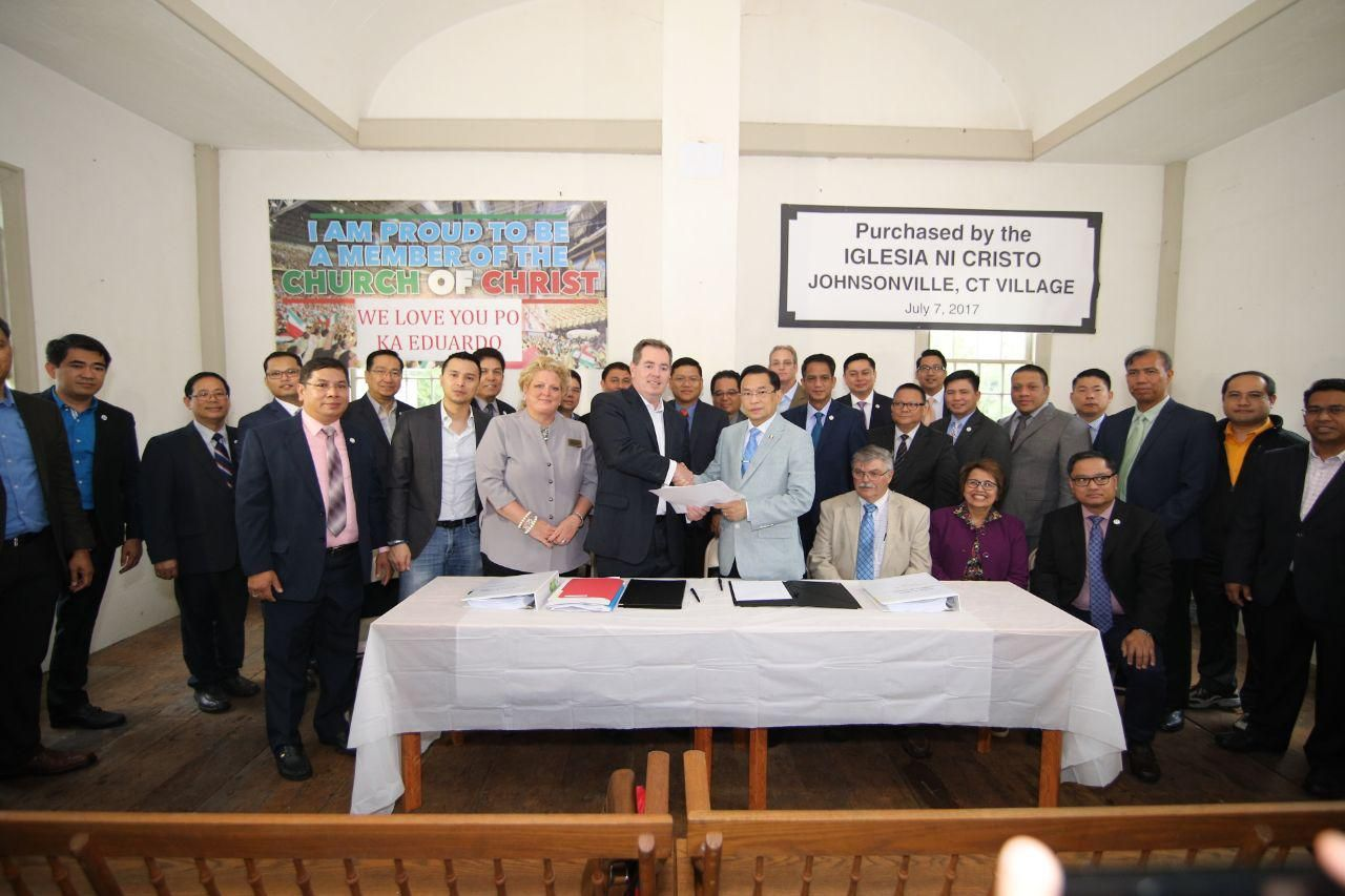 Officials with Iglesia Ni Cristo and East Haddam, Connecticut, marked the closing Johnsonville's sale at a news conference this month. (Courtesy Iglesia Ni Cristo)