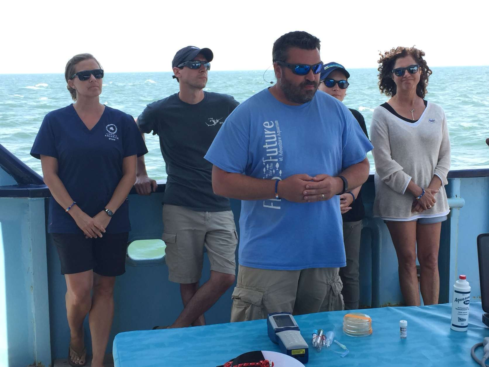 Mike Hyatt, chief scientist of OCEARCH, leads a science brief, where scientists spoke about their projects aboard the OCEARCH. (WTOP/Michelle Basch)