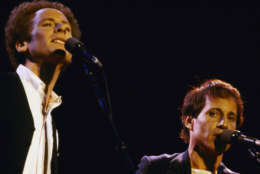 Art Garfunkel, left (wearing vest) and Paul Simon serenade an audience estimated close to one-half million in New York's Central Park at a free concert Sept. 19, 198. The Duo, reunted on stage after an 11-year separation, sang many of the songs from their hit albums of the 1960's. (AP Photo/Nancy Kaye)