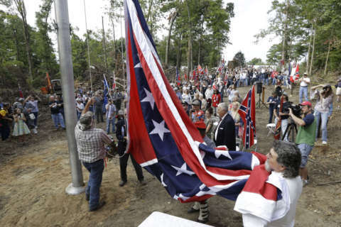Amid controversy over memorials, group vows more Confederate battle flags along Va. highways