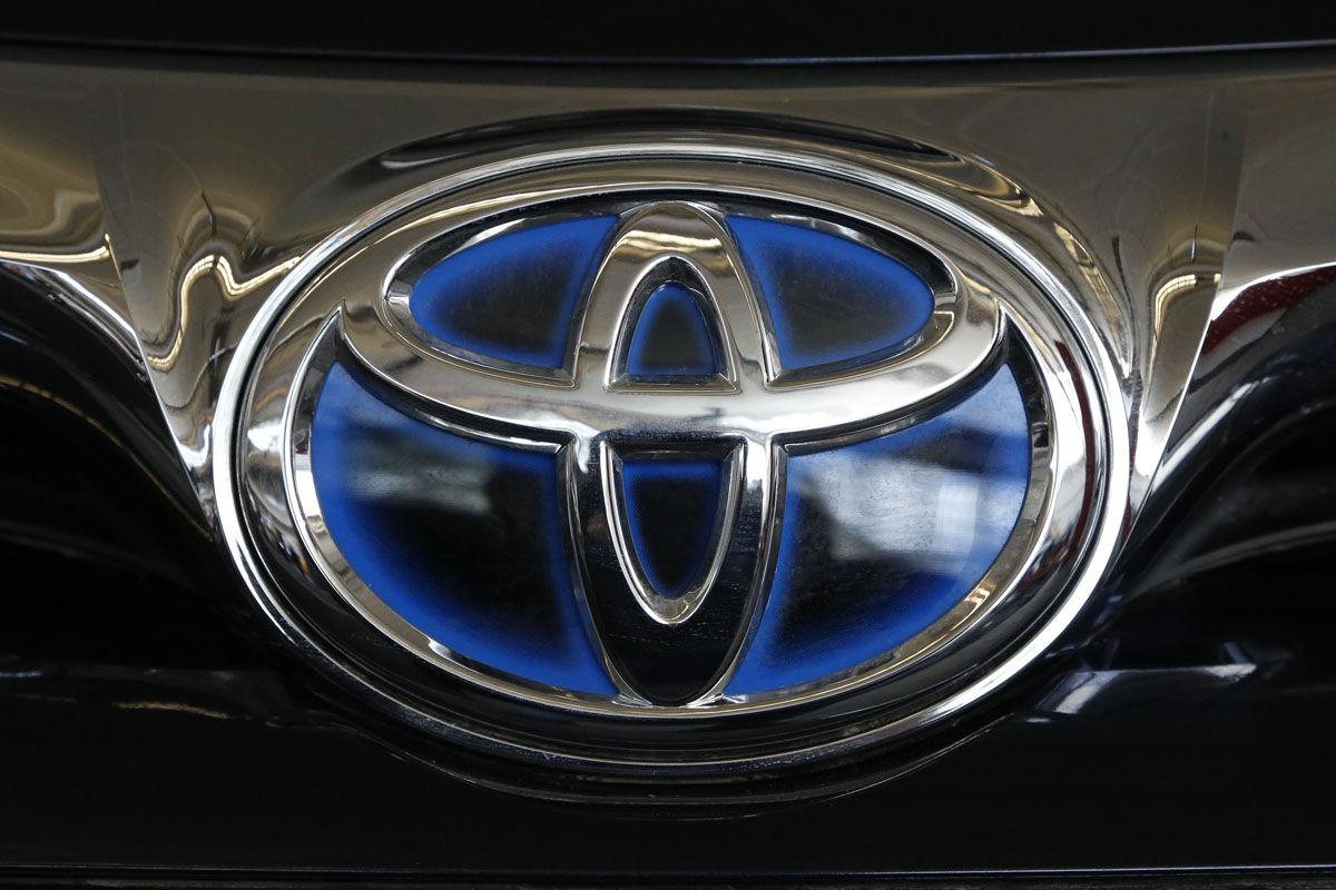 This is the Toyota logo on the hood of a 2016 Toyota Avalon hybrid sedan on display at the Pittsburgh International Auto Show in Pittsburgh Thursday, Feb. 11, 2016. (AP Photo/Gene J. Puskar)