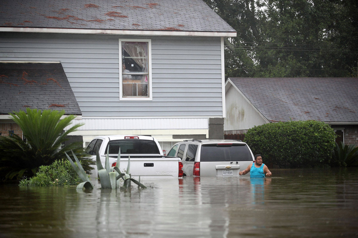 HOUSTON, TX - AUGUST 28:  People wait to be rescued from their  flooded homes after the area was inundated with flooding from Hurricane Harvey on August 28, 2017 in Houston, Texas. Harvey, which made landfall north of Corpus Christi late Friday evening, is expected to dump upwards to 40 inches of rain in Texas over the next couple of days.  (Photo by Joe Raedle/Getty Images)