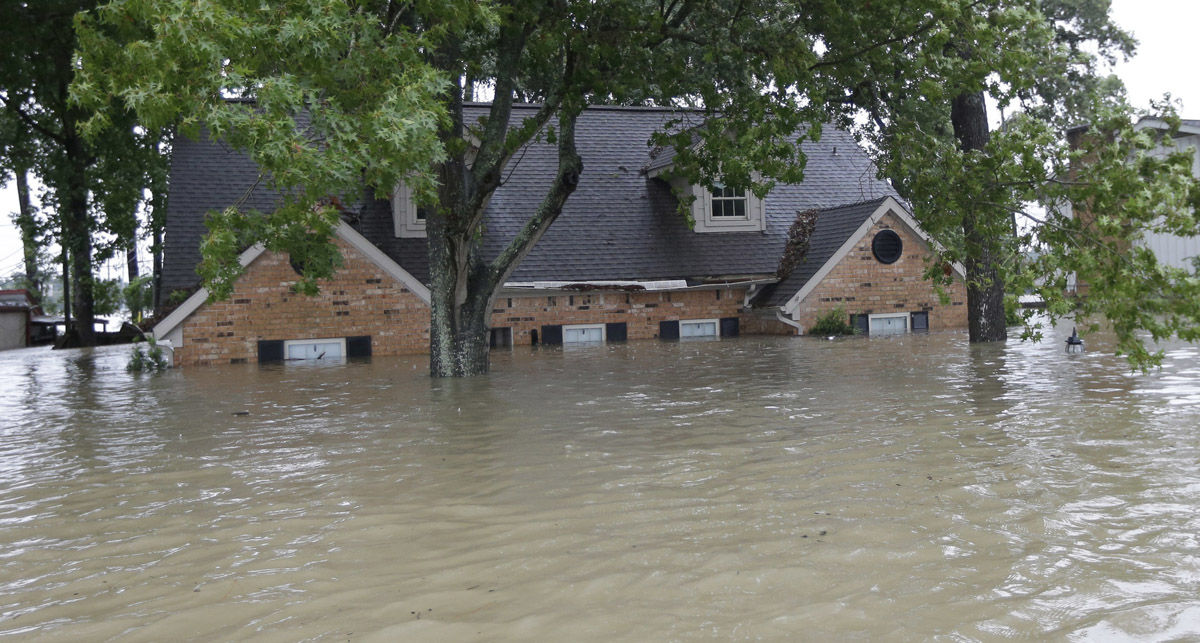 A flooded home is shown as floodwaters from Tropical Storm Harvey rise Monday, Aug. 28, 2017, in Spring, Texas. (AP Photo/David J. Phillip)