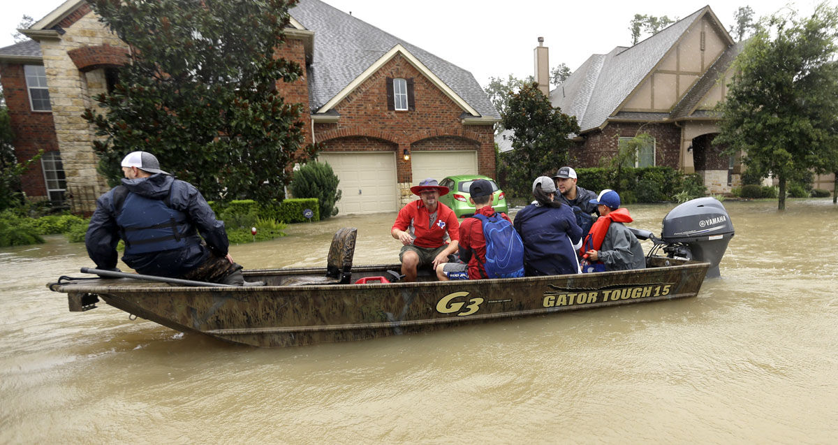 Residents are evacuated as floodwaters from Tropical Storm Harvey rise Monday, Aug. 28, 2017, in Spring, Texas. (AP Photo/David J. Phillip)