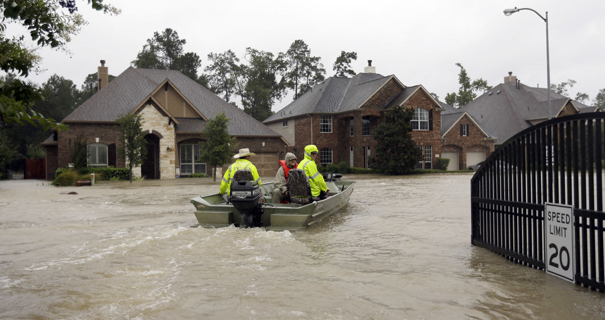 Volunteer rescue boats enter a flooded subdivision looking to evacuate residents as floodwaters from Tropical Storm Harvey rise Monday, Aug. 28, 2017, in Spring, Texas. (AP Photo/David J. Phillip)