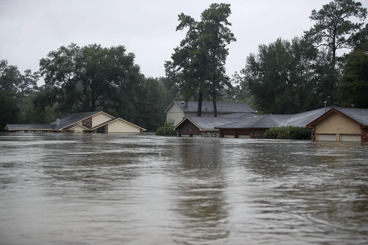 HOUSTON, TX - AUGUST 28:  Homes are seen inundated with flooding from Hurricane Harvey on August 28, 2017 in Houston, Texas. Harvey, which made landfall north of Corpus Christi late Friday evening, is expected to dump upwards to 40 inches of rain in Texas over the next couple of days.  (Photo by Joe Raedle/Getty Images)