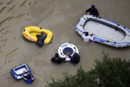 Residents wade through floodwaters near the Addicks Reservoir as floodwaters from Tropical Storm Harvey rise Tuesday, Aug. 29, 2017, in Houston. (AP Photo/David J. Phillip)