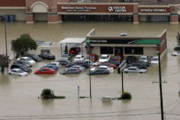 Businesses and cars are flooded near the Addicks Reservoir as floodwaters from Tropical Storm Harvey rise Tuesday, Aug. 29, 2017, in Houston. (AP Photo/David J. Phillip)