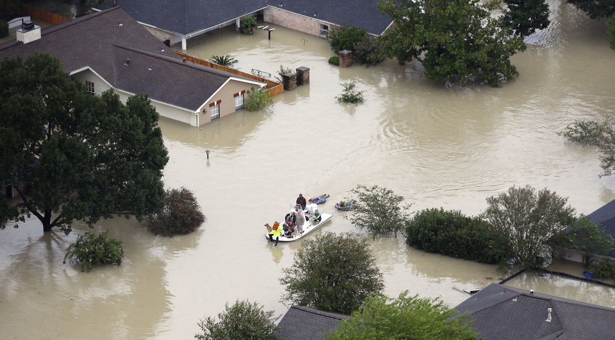 Residents evacuate their homes near the Addicks Reservoir as floodwaters from Tropical Storm Harvey rise Tuesday, Aug. 29, 2017, in Houston. (AP Photo/David J. Phillip)