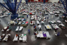 HOUSTON, TX - AUGUST 29:  People take shelter at the George R. Brown Convention Center after flood waters from Hurricane Harvey inundated the city on August 29, 2017 in Houston, Texas. The evacuation center which is overcapacity has already received more than 9,000 evacuees with more arriving.  (Photo by Joe Raedle/Getty Images)