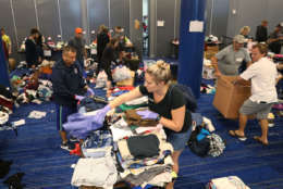 HOUSTON, TX - AUGUST 29:  Volunteers sort through donated clothing for the people that have taken shelter at the George R. Brown Convention Center after flood waters from Hurricane Harvey inundated the city on August 29, 2017 in Houston, Texas. The evacuation center which is overcapacity has already received more than 9,000 evacuees with more arriving.  (Photo by Joe Raedle/Getty Images)