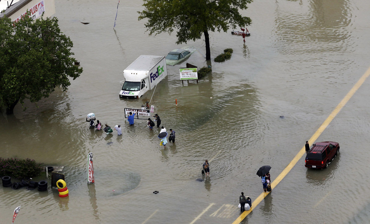 Residents evacuate near the Addicks Reservoir as floodwaters from Tropical Storm Harvey rise Tuesday, Aug. 29, 2017, in Houston. (AP Photo/David J. Phillip)