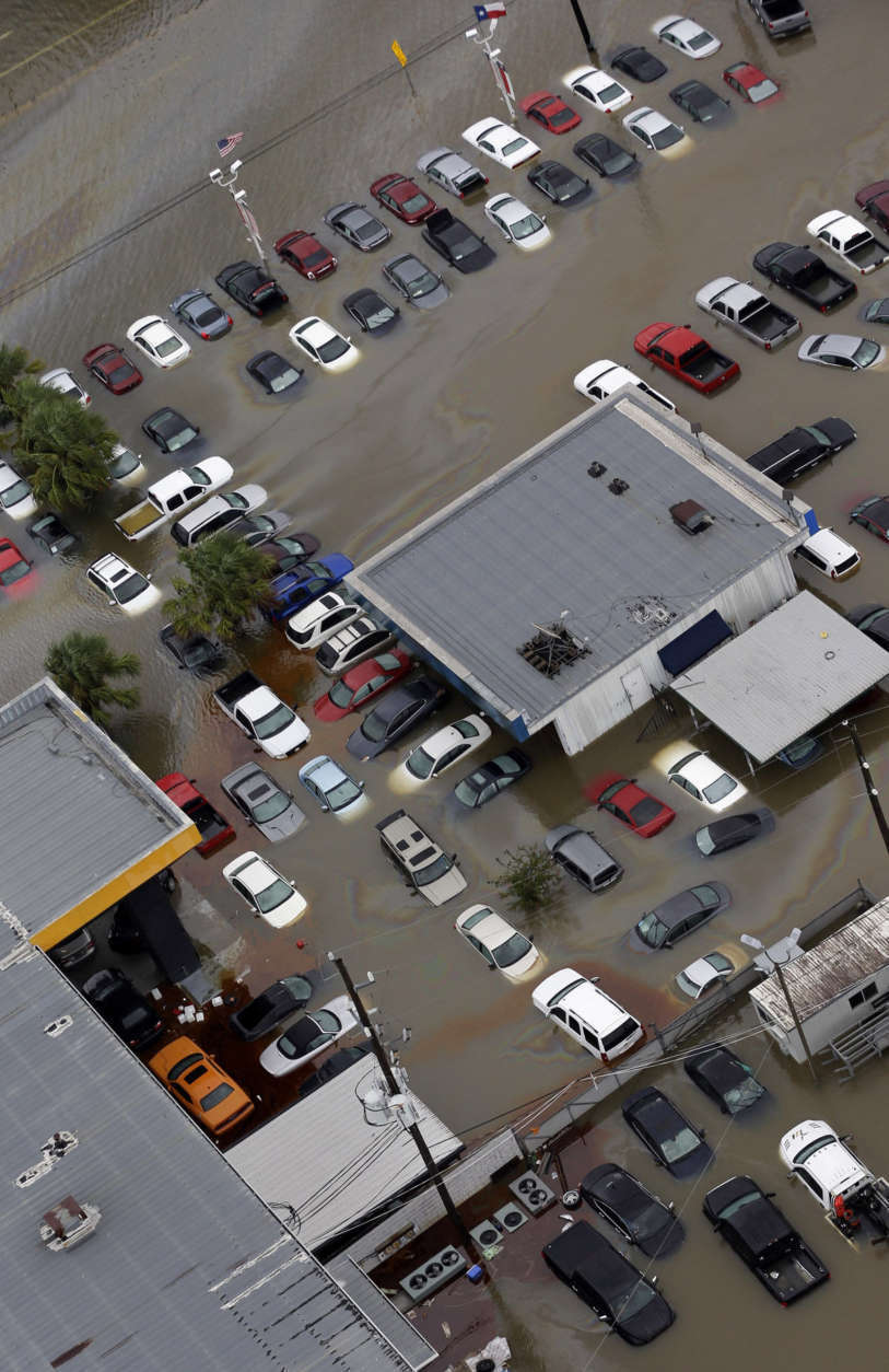 Cars and businesses are flooded near the Addicks Reservoir as floodwaters from Tropical Storm Harvey rise Tuesday, Aug. 29, 2017, in Houston. (AP Photo/David J. Phillip)