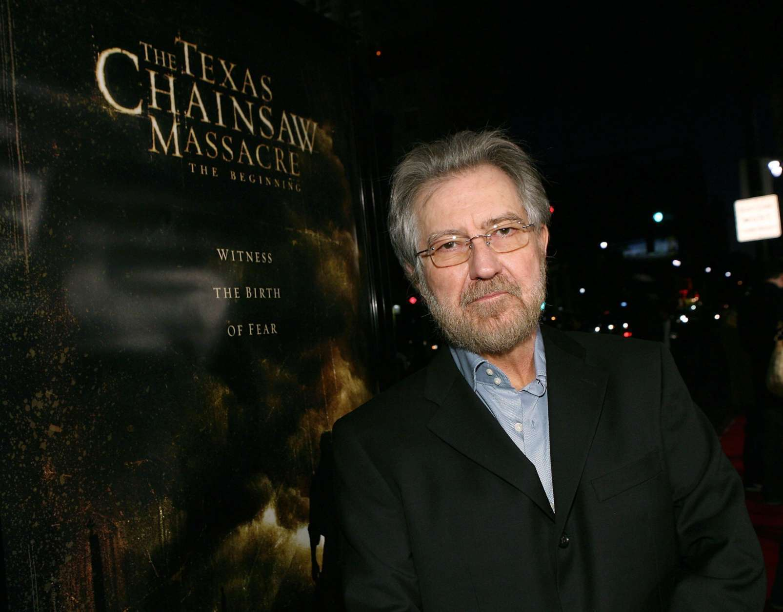 """LOS ANGELES, CA - OCTOBER 05:  Producer Tobe Hooper arrives at the premiere of New Line's """"Texas Chainsaw Massacre: The Beginning"""" at Grauman's Chinese Theatre on October 5, 2006 in Los Angeles, California. Hooper <a href=""""http://wtop.com/movies/2017/08/tobe-hooper-master-of-horror-behind-the-texas-chain-saw-massacre-dies-at-74/"""" target=""""_blank>died Aug. 27. </a> (Photo by Michael Buckner/Getty Images)"""