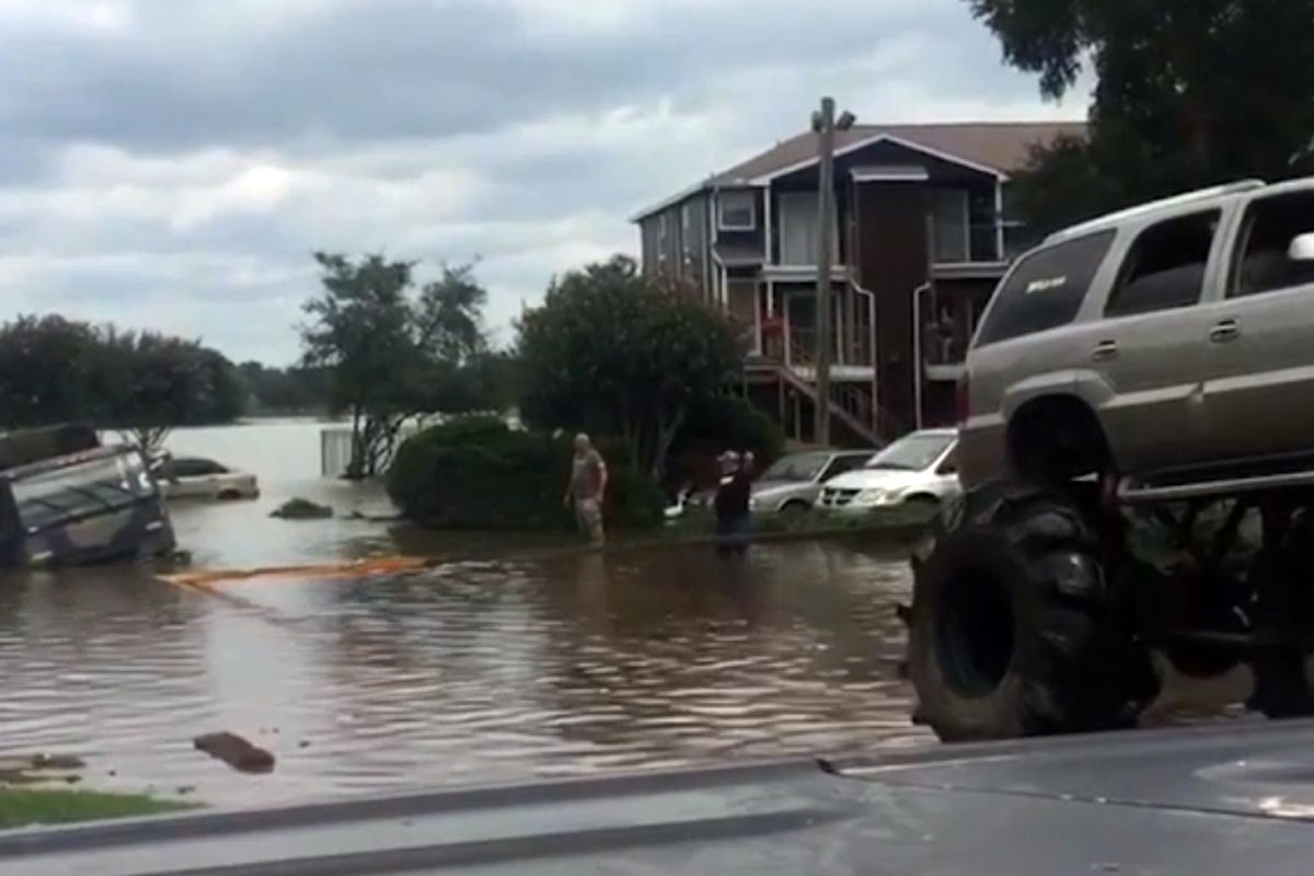 fleet of monster trucks conducts rescues in floodravaged