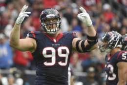 FILE - In this Jan. 3, 2016, file photo, Houston Texans defensive end J.J. Watt (99) gestures during the first half of an NFL football game against the Jacksonville Jaguars, in Houston. Many observers believe you can put a blanket over Houston, Tennessee and Indianapolis because their talent bases are that close. We demur. The Texans have a terrific defense that gets back the incomparable Watt and could be enough to overcome a mediocre offense with an unproven QB and suspect passing game. They are well coached and rarely beat themselves, until the playoffs, that is. (AP Photo/Eric Christian Smith, File)