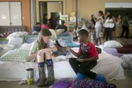 Volunteer Elizabeth Hill, 8, plays with evacuee Skyler Smith, 7, at a shelter at St. Thomas Presbyterian Church in west Houston as Tropical Storm Harvey continues to affect the area Tuesday, Aug. 29, 2017. (Jay Janner/Austin American-Statesman via AP)