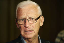 """FILE - In this June 23, 2015, file photo, Ottawa Senators then-general manager Bryan Murray speaks with reporters after a meeting of NHL hockey GMs in Las Vegas. While the NHL holds its annual month-long """"Hockey Fights Cancer"""" initiative, the Senators are a reminder that the fight doesn't stop. The Senators have been particularly hard hit by the disease as assistant coach Mark Reeds died last year at 55, former general manager Murray continues his fight against terminal colon cancer and public-address announcer """"Stuntman"""" Stu Schwartz battled leukemia. Recently, goaltender Craig Anderson's wife, Nicholle, was diagnosed with cancer. (AP Photo/John Locher, File)"""