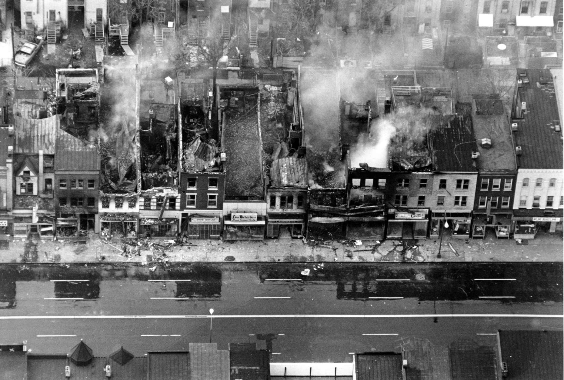 This aerial photo shows fire-gutted buildings, some still smouldering, along a block on H Street between 12th and 13th Streets in the northeast section of Washington, D.C. on April 5, 1968. Rioting broke out after the assassination of civil rights leader Dr. Martin Luther King, Jr., in Memphis, Tenn. on April 4. (AP Photo)