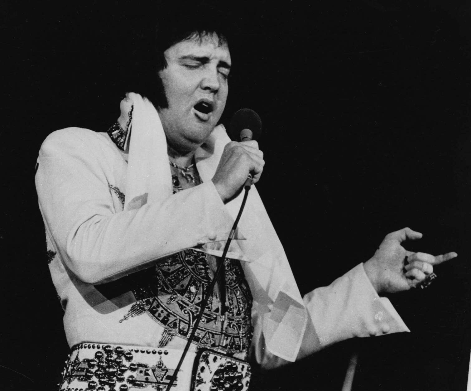 Elvis Presley is shown performing in Providence, R.I. on May 23, 1977, three months before his death. (AP Photo)