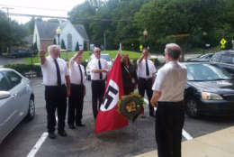 Neo Nazis perform the Nazi salute in Dominion Hills Shopping Center to commemorate the 50th anniversary of killing of George Lincoln Rockwell, the founder of the American Nazi Party. (Courtesy Matt Garcia)
