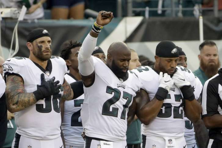 See the powerful photo of Chris Long supporting Malcolm Jenkins during protest
