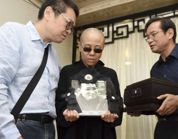 Widow of late Chinese Nobel laureate reappears in video