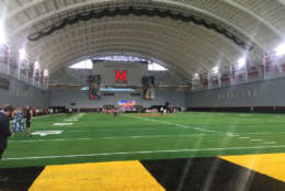 """It's a game cahnger for us with our team, with the development, with what we'll be able to do on a day-to-day basis here,"" said Terrapins football coach DJ Durkin in regards to the new practice facility at Cole Field House. (WTOP/Max Smith)"