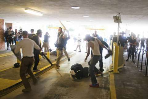 Warrant issued for man beaten during Charlottesville rally