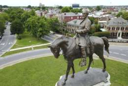 FILE - This Tuesday, June 27, 2017 photo shows the statue of Confederate Gen. Robert E. Lee that stands in the middle of a traffic circle on Monument Avenue in Richmond, Va. As cities across the United States are removing Confederate statues and other symbols, dispensing with what some see as offensive artifacts of a shameful past marked by racism and slavery, Richmond is taking a go-slow approach. (AP Photo/Steve Helber)