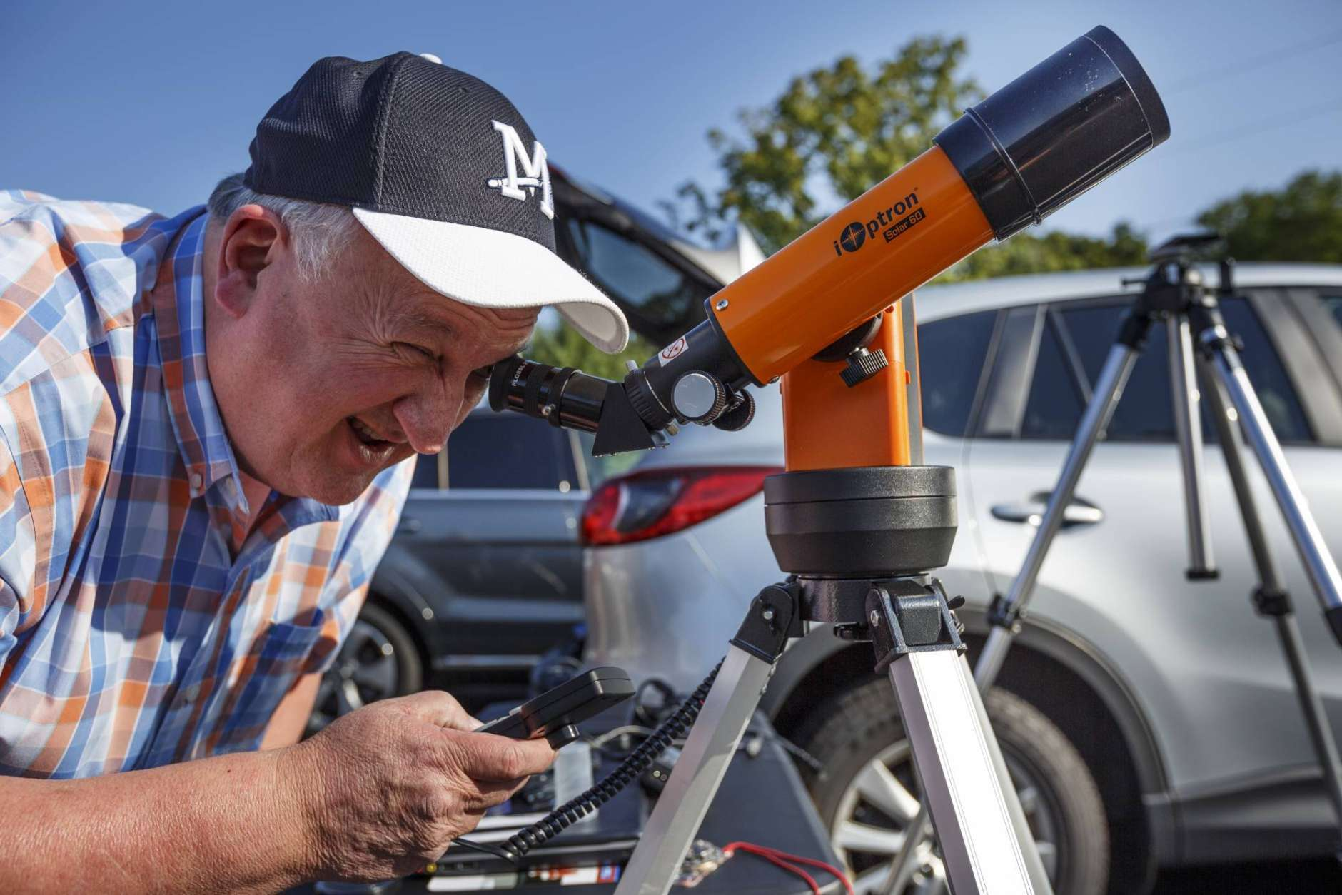 Tim Lucas looks through a telescope as he gets ready to view the total solar eclipse on Monday, Aug. 21, 2017, in Spring City, Tenn. (Doug Strickland/Chattanooga Times Free Press via AP)