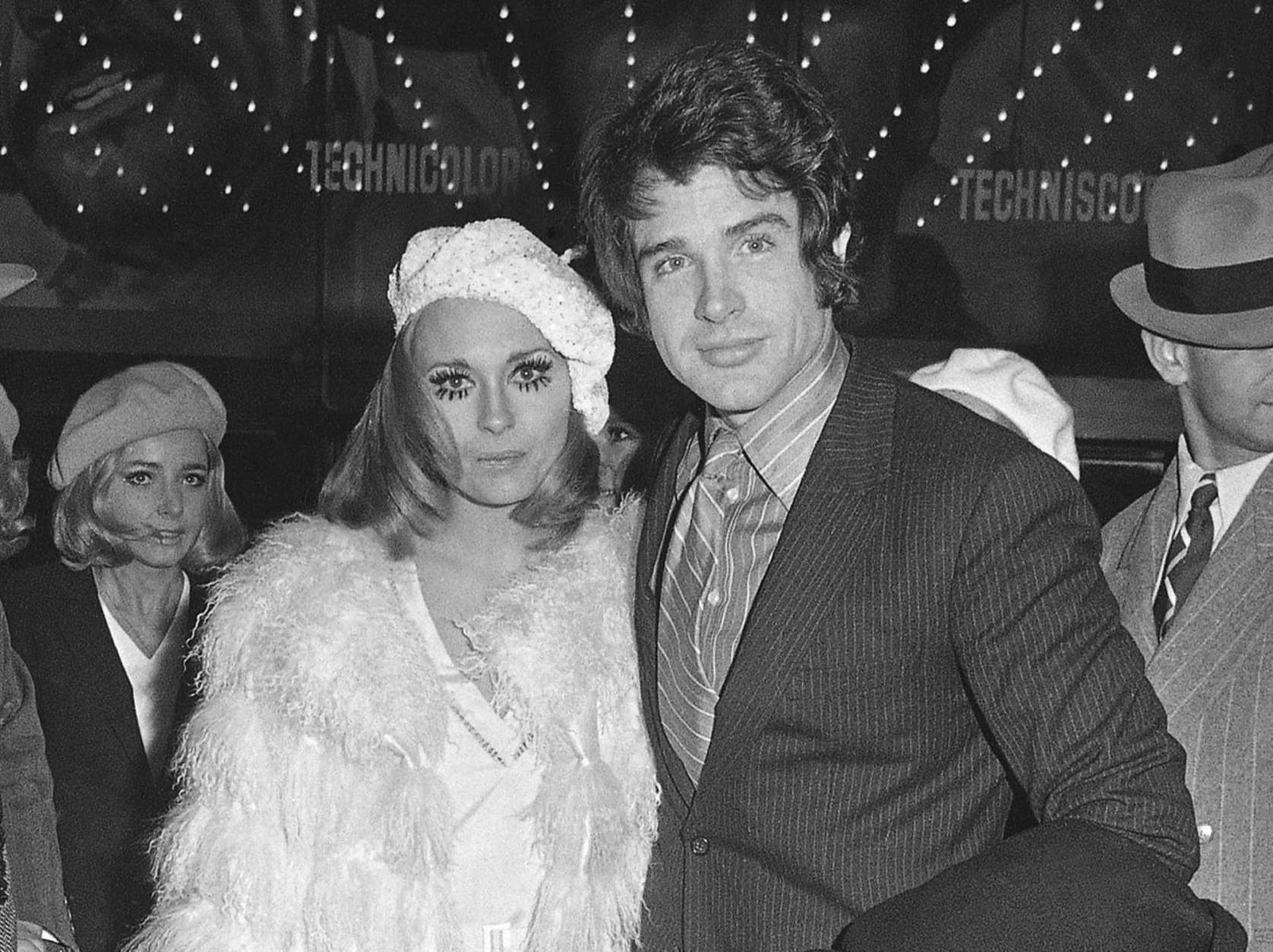 """FILE - In this Jan. 24, 1968, file photo,  Faye Dunaway, left, and Warren Beatty appear at the Paris premiere of their film, """"Bonnie and Clyde."""" The film premiered in the U.S. in September 1967. The film, starring Beatty and Faye as the fatalistic outlaws, would become a cultural sensation, one of the biggest box office hits up until that point and a 10-time Oscar nominee. But on its initial release on August 13 in the midst of the Summer of Love, """"Bonnie and Clyde"""" was virtually gunned down by bad reviews and a tepid reception at the box office. (AP Photo/Michel Lipchitz, File)"""