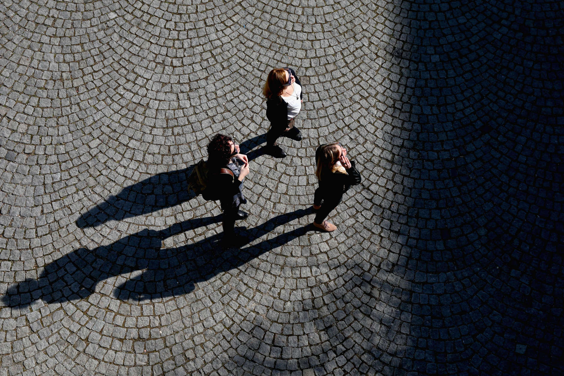 MUNICH, GERMANY - MARCH 20:  People use special glasses to look into the sky at a partial solar eclipse on March 20, 2015 in Munich, Germany. Over Central Europe the moon was scheduled to cover approximately 75% of the sun for a short period starting at approximately 9:30am. The next solar eclipse will not occur until 2021.  (Photo by Alexander Hassenstein/Getty Images)
