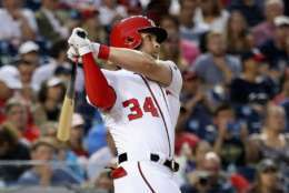 WASHINGTON, DC - AUGUST 07:  Bryce Harper #34 of the Washington Nationals follows his fourth inning solo home run against the Miami Marlins at Nationals Park on August 7, 2017 in Washington, DC.  (Photo by Rob Carr/Getty Images)
