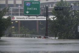 Floodwaters from Tropical Storm Harvey overflow Buffalo Bayou in Houston, Texas, Monday, Aug. 28, 2017. (AP Photo/LM Otero)