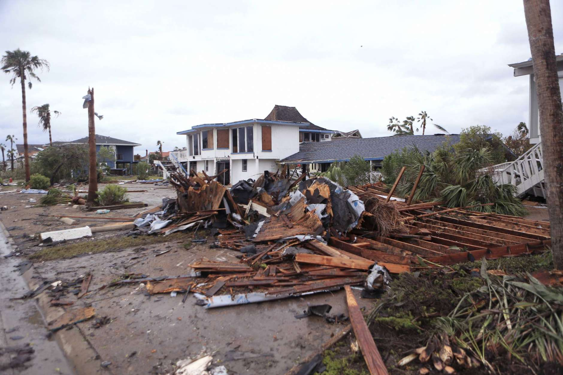 Debris lies on the ground near homes in the Key Allegro subdivision of Rockport, Texas in the wake of Hurricane Harvey on Monday, Aug. 28, 2017. (Rachel Denny Clow/Corpus Christi Caller-Times via AP)
