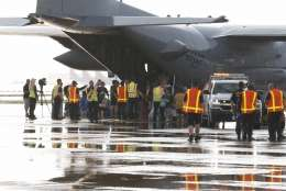 Evacuees from Tropical Storm Harvey arrive at Dallas Love Field on a military aircraft in Dallas on Monday, Aug. 28, 2017. Floodwaters reached the rooflines of single-story homes Monday and people could be heard pleading for help from inside as Harvey poured rain on the Houston area for a fourth consecutive day after a chaotic weekend of rising water and rescues. (David Woo/The Dallas Morning News via AP)