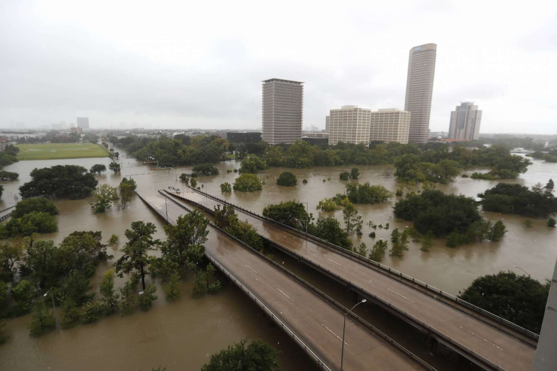 An overhead view of the flooding in Houston, from Buffalo Bayou on Memorial Drive and Allen Parkway, as heavy rains continue falling from Tropical Storm Harvey, Monday, Aug. 28, 2017. ( Karen Warren/Houston Chronicle via AP)