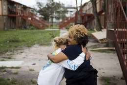 """Genice Gipson hugs her lifelong friend, Loretta Capistran, outside of Capistran's apartment complex in Refugio, Texas, on Monday, Aug. 28, 2017. """"We got to be strong, baby,"""" Gipson told Capistran. (Nick Wagner/Austin American-Statesman via AP)"""