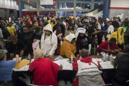 Thousands take shelter from the Tropical Storm Harvey at the George R. Brown Convention Center in Houston on Monday, Aug. 28, 2017. Floodwaters reached the rooflines of single-story homes Monday and people could be heard pleading for help from inside as Harvey poured rain on the Houston area for a fourth consecutive day after a chaotic weekend of rising water and rescues. (Marie D. De Jesus/Houston Chronicle via AP)
