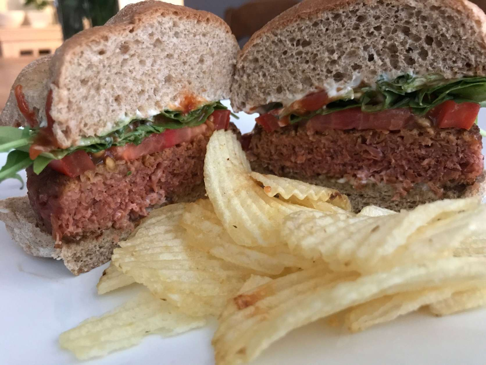 The Beyond Burger is not a veggie burger. There are no visible greens, grains or carrots bound by egg and breadcrumbs. Instead, it's made from protein that's been extracted from legumes and pulses, then heated and cooled to achieve the desired meat-like consistency. (WTOP/Rachel Nania)
